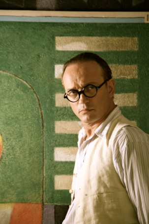 Vincent Perez as Le Corbusier with a fresco of his nemesis in the background